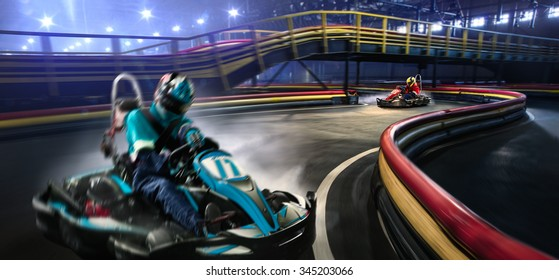 Two karting racers are racing on the grand track motion