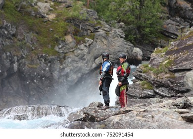 Two kayaker man on the river bank. LOM - AUG 3: Two kayaker man on the river bank. Aug 3, 2014 in Lom, Norway