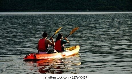 Two Kayakers with Life Vests or Life Jackets.