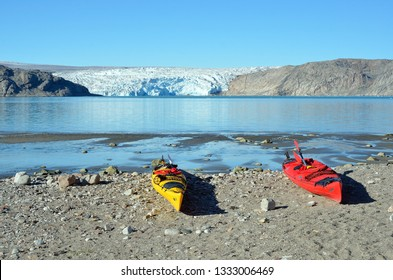 Two kayaks in fron of the Artic ice pack, Greenland