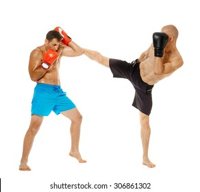 Two kickbox fighters sparring, full length isolated on white background