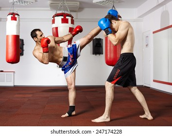 Two kickbox fighters training in the gym