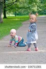 two kid walking in park