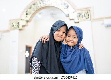 two kids bestfriend muslim while on the mosque