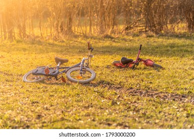 Two kids bikes abandoned on the ground. Evokes lost or kidnapped children. Crime or thriller theme.