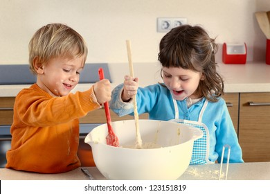 Two kids cooking in a domestic kitchen