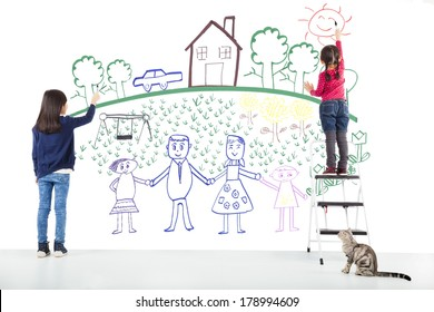 two kids drawing their dream on the white wall