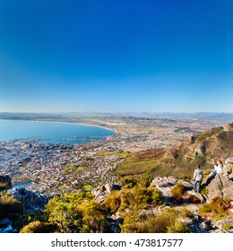 Two kids enjoying breathtaking views of Cape Town from top of Table mountain