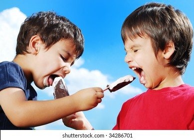 Two kids feeding each other ice cream