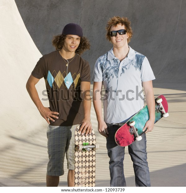 Two kids hang out at the skate park
