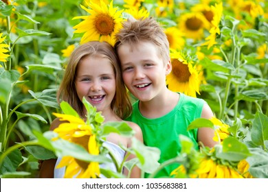 Two kids having fun among sunflower field
