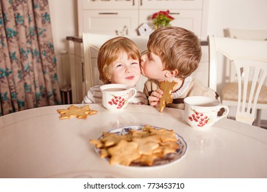 Two kids in kitchen cooking. Little boy and girl making cookies