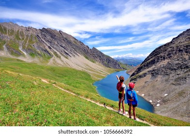 Two kids at the lake in mountains