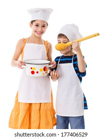 Two kids with pan and big ladle tasting the soup, isolated on white