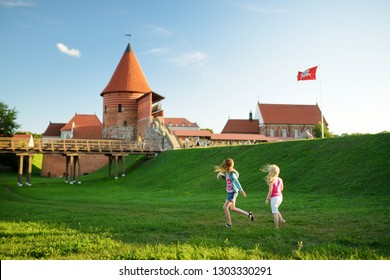 Two kids playing near Kaunas castle, originally built during the mid-14th century, situated in Kaunas, Lithuania