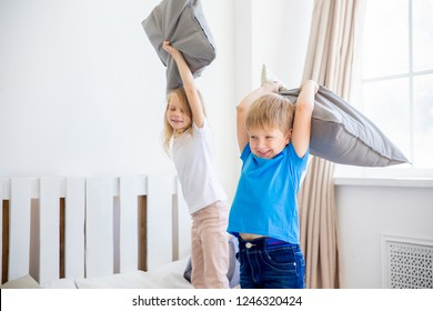 two kids playing together and making a mess at home
