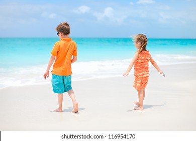 Two kids playing at tropical beach