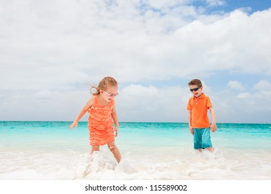 Two kids playing at tropical shallow water