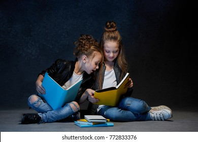 Two kids reading the books at studio