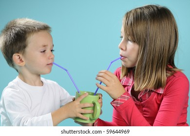 two kids sharing and drinking juice