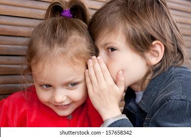 two kids sharing secret