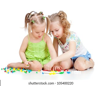 two kids sisters play together, isolated on white background