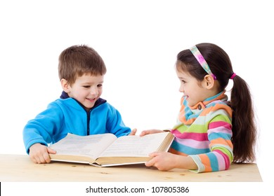 Two kids at the table sharing the book, isolated on white
