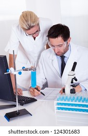 Two lab technicians at work in a laboratory
