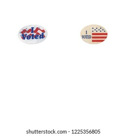 Two lables given out at the polling places that say I voted. Isolated on white with copy space, square crop