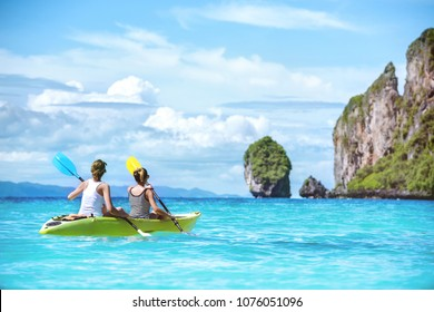 Two ladies are kayaking or kanoeing at beautuful tropical lagoon at Phi-Phi islands. Krabi province, Thailand