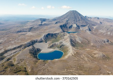 Two lakes in the Tongariro national park in front of mount Ngauruhoe