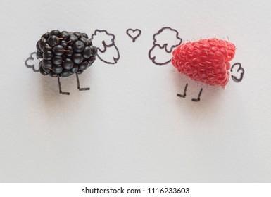 two lamb raspberries and blackberries - love