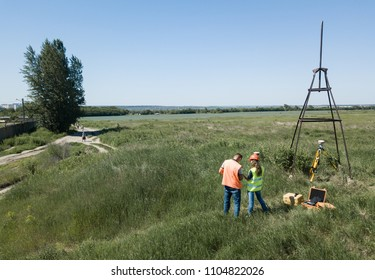 Two land surveyors a construction site