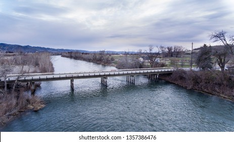 Two lane bridge over the water of a river