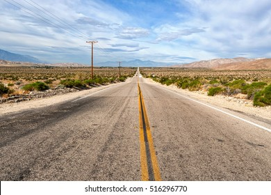 Two lane desert highway between Indio and Palm Springs, California