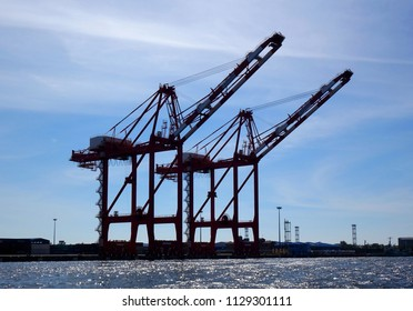 Two large cranes used for loading containers on to ships