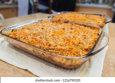 Two Large Glass Casserole Dishes of Baked Pasta and Cheese Gratin Casserole