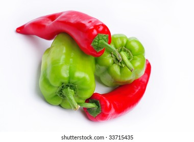 Two large green red peppers and two long red peppers