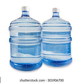 Two large plastic transparent carboys, capacity 5 gallons (19 liter), for water coolers with drinking water on a light background. Isolation.