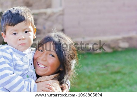 two latin siblings hugging outside stock photo edit now 1066805894