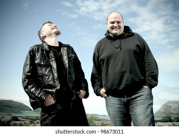 two laughing friends outdoors in summer