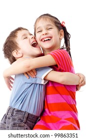 Two laughing funny kids standing together and embracing, isolated on white