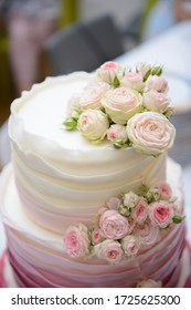 Two layered wedding cake with roses.
