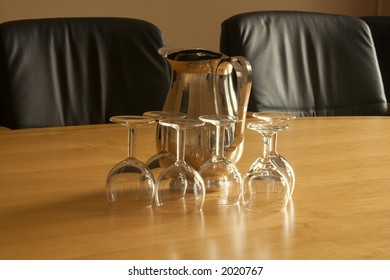 Two leather chairs in executive boardroom prior to a meeting or interview