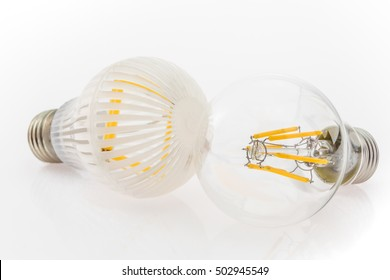 two LED bulbs with different cover, plastic and glass, focusing on the bulb in the foreground
