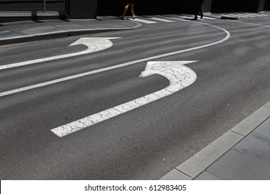 Two left arrows on a road