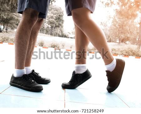 Uniform gay men kiss photo
