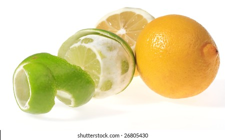 Two lemons and lime over white background