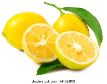 Two Lemons - one sliced in half - on white background.
