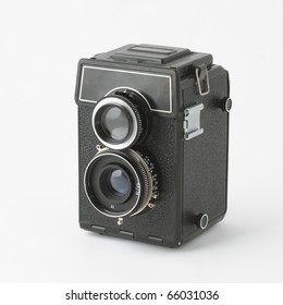 Two lens reflex old photo camera isolated on white background
